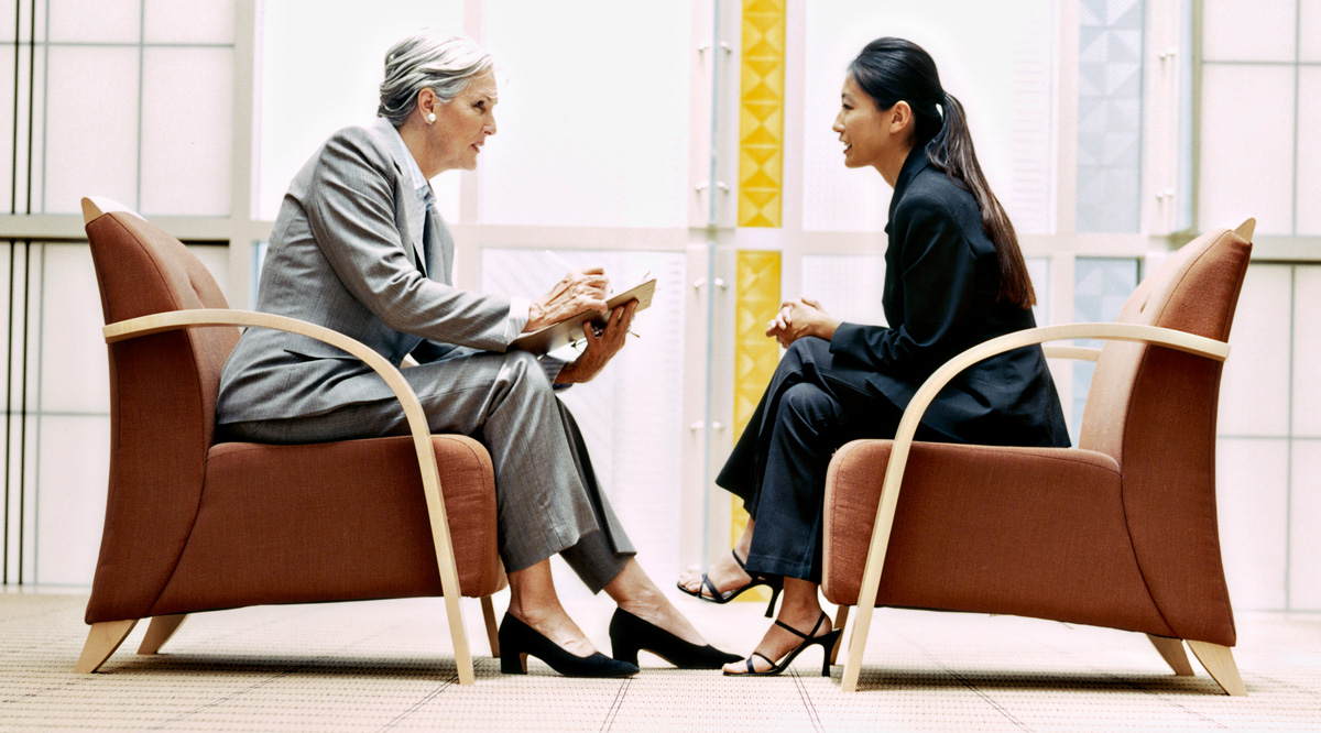 One woman interviewing another in a business setting