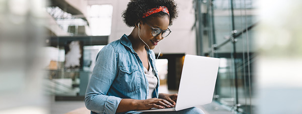 Photo of woman at laptop