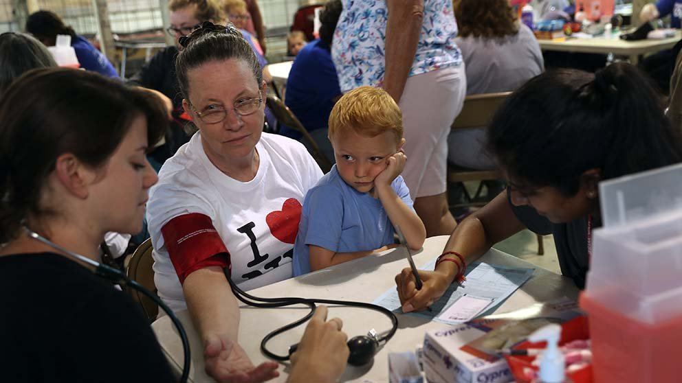 Ruby Partin and her adoptive son visit a free health clinic Wise, Virginia, in 2017.