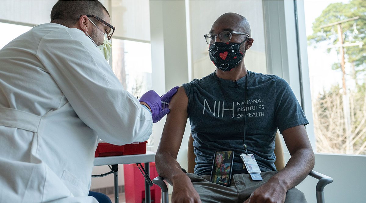 Taison Bell, MD, gets one of the first Pfizer coronavirus vaccinations at UVA Health on Dec. 15.