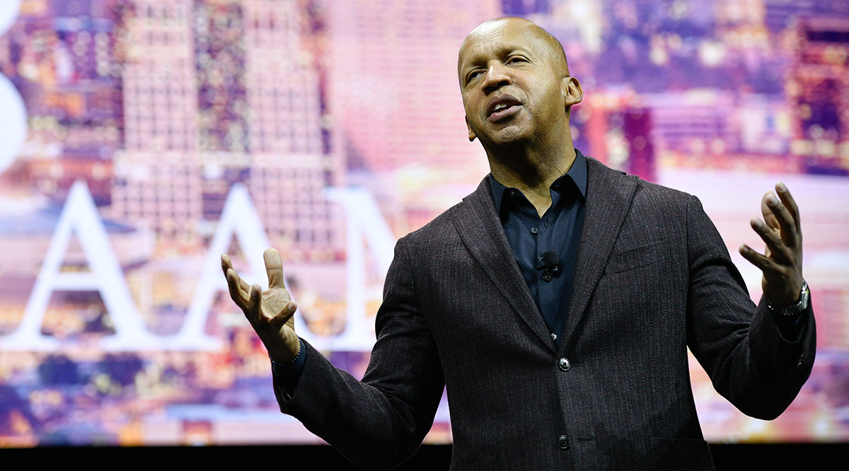 Civil rights attorney and author Bryan Stevenson delivers a speech on stage.