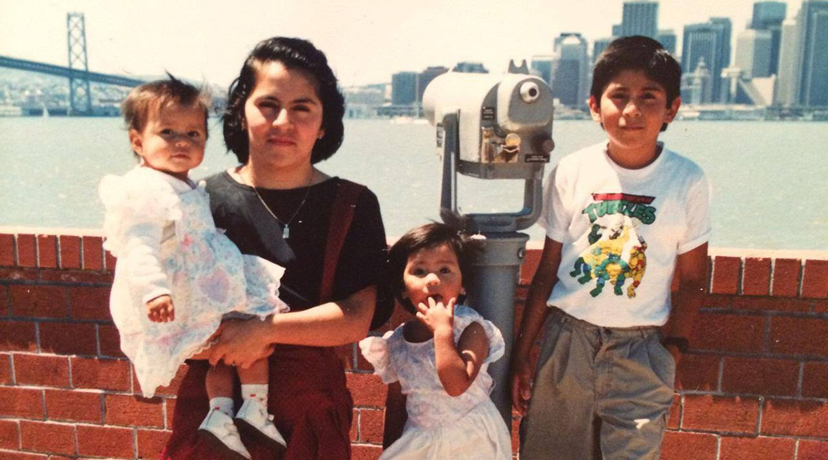 Denisse Rojas Marquez, MD, MPP, with her mother and siblings as an infant.