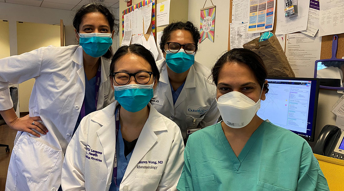 Hemali Patel, MD, (in green scrubs), a hospitalist with the University of Texas at Austin Dell Medical School, poses with her team at NYU Langone Health. Patel spent a week volunteering to care for patients at NYU Langone