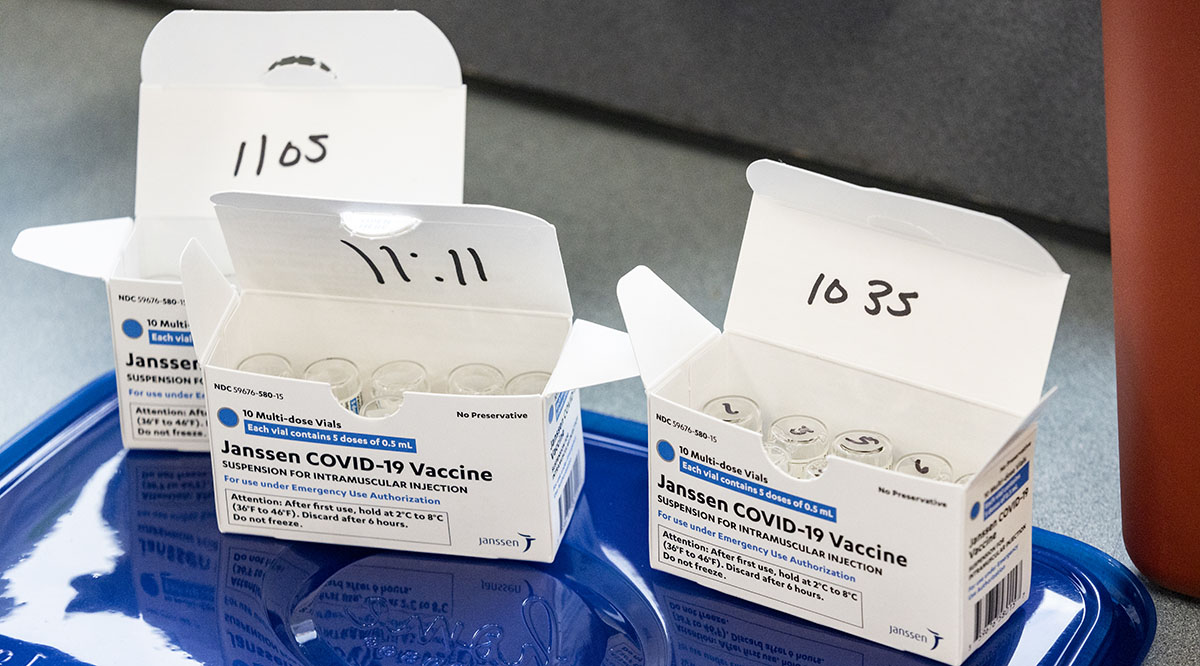 Boxes of the J&J COVID-19 vaccine are prepared for distribution in West Virginia in March 2021.