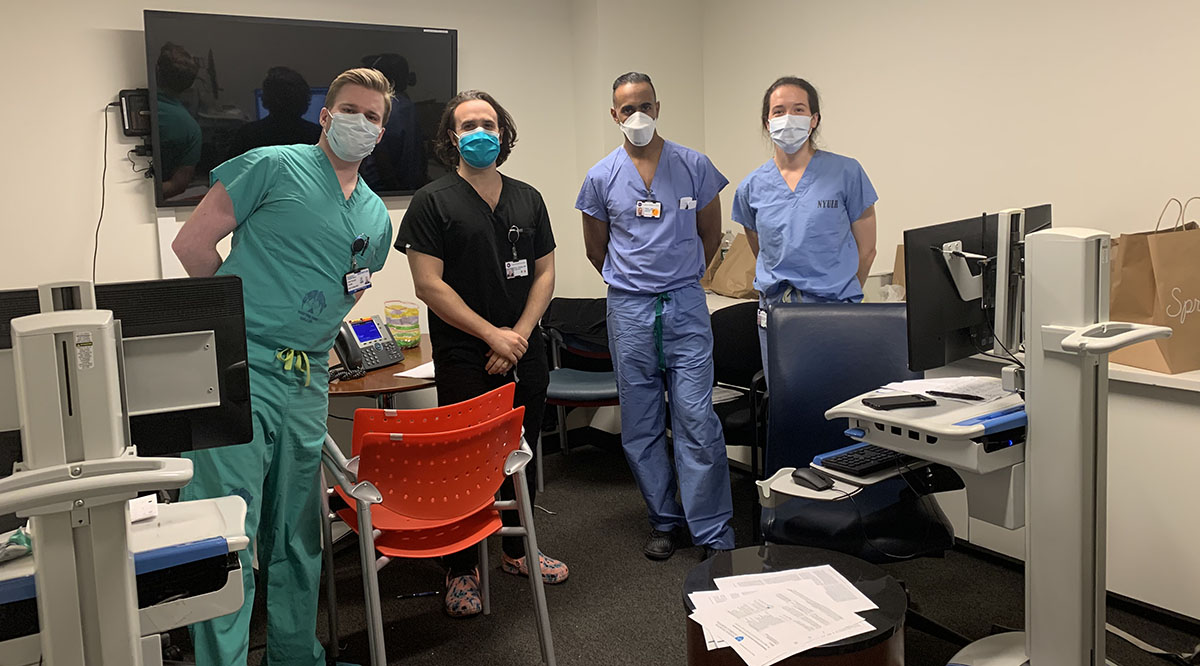 Jaison John, MD, second from right, a hospitalist with the University of Texas at Austin Dell Medical School, is shown with his team at NYU Langone Health. John volunteered to care for COVID-19 patients at NYU Langone for a week in early April
