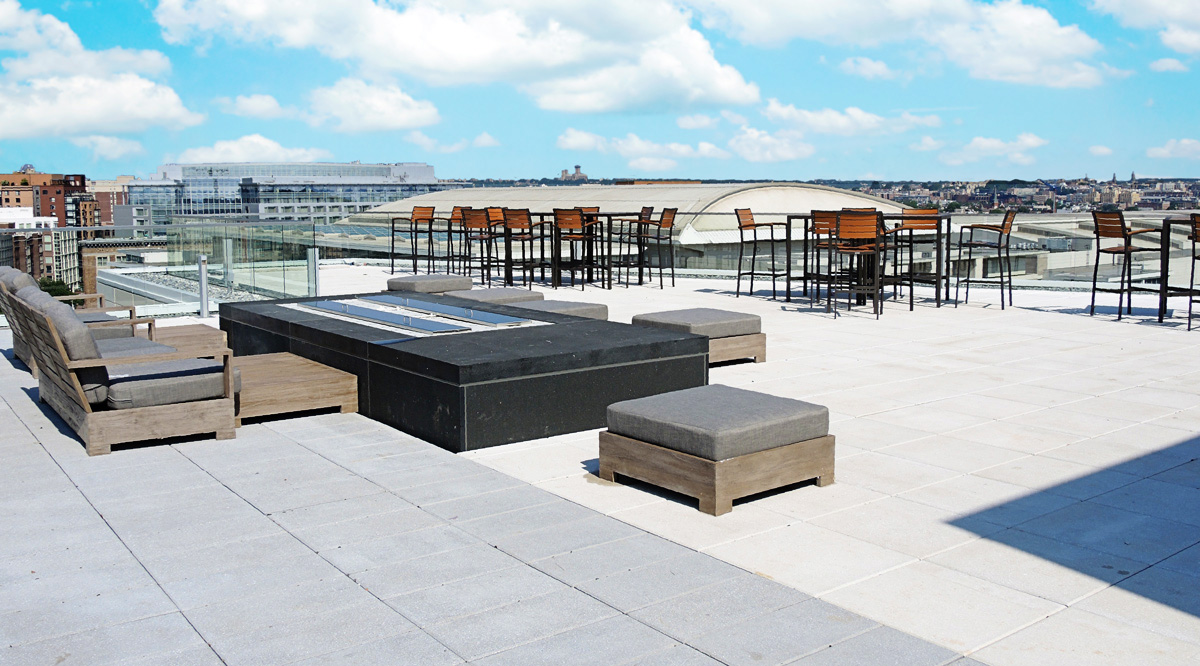 Building's rooftop with tables and chairs