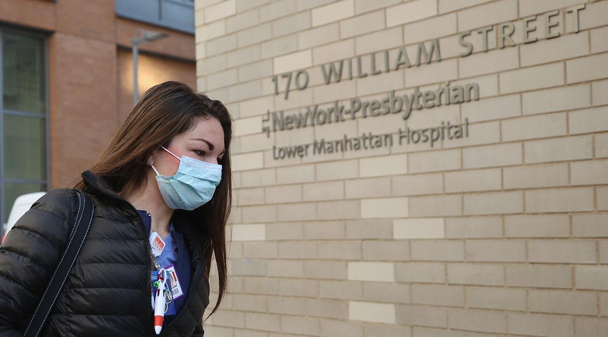 An employee of NewYork-Presbyterian Lower Manhattan Hospital arrives for work on April 02, 2020 in New York City.