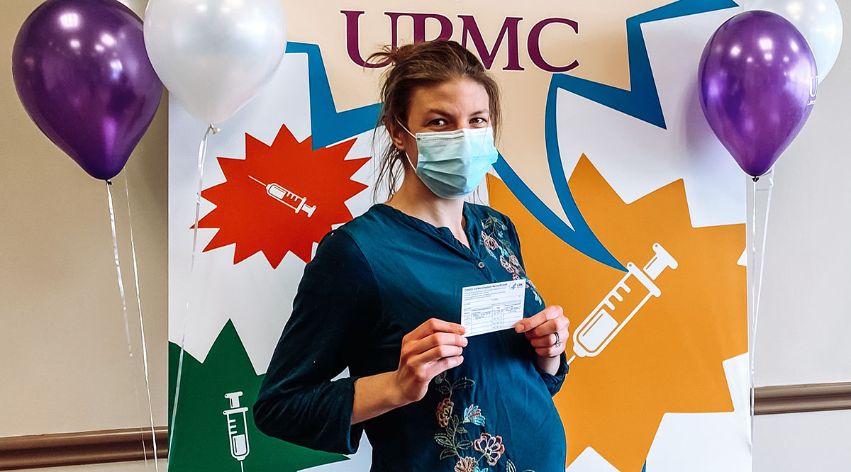 Victoria Heinrich, an MD-PhD student at the University of Pittsburgh, poses after getting her COVID-19 vaccine while 20 weeks pregnant.