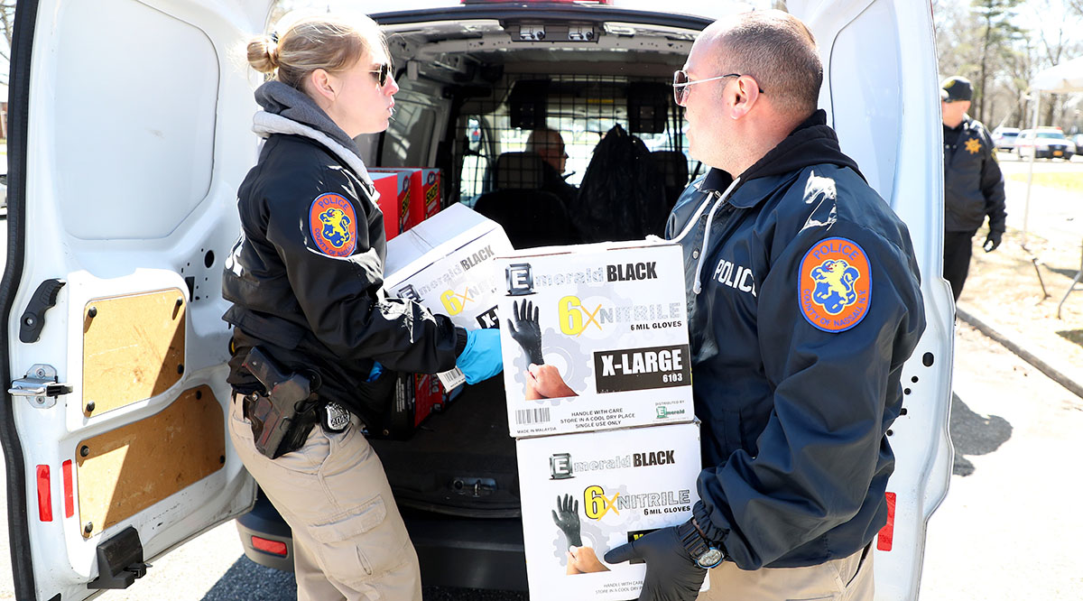 Police in East Meadow, New York, lead a donation drive to collect medical equipment such as N95 surgical masks, nitrile gloves, tyvex suits, and antibacterial and disinfecting wipes to battle the coronavirus pandemic on March 24, 2020