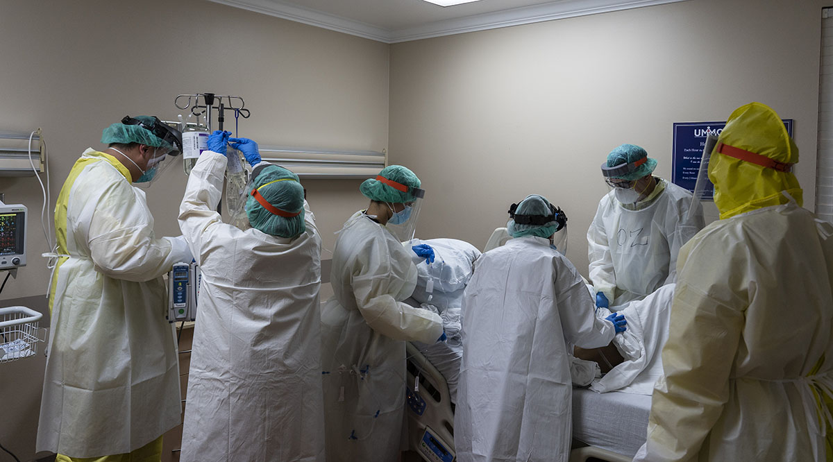 Members of the medical staff at the United Memorial Medical Center in Houston, Texas, treat a patient in the COVID-19 intensive care unit on July 2, 2020