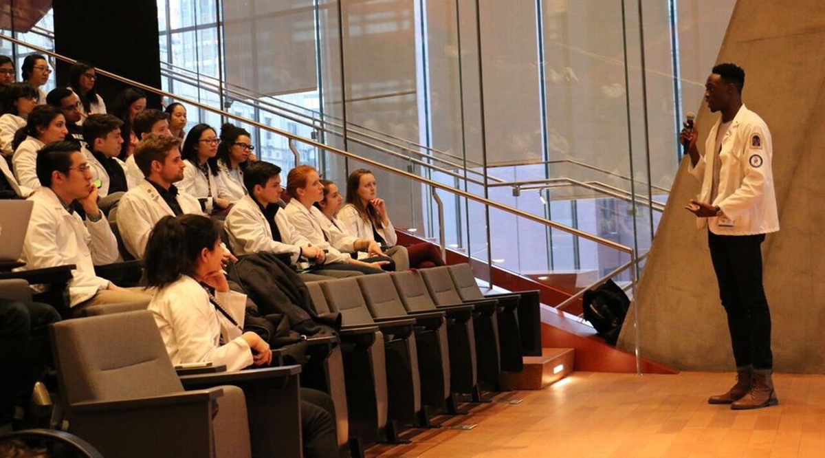 Taiwo Alonge speaks to students and faculty at Columbia University Vagelos College of Physicians and Surgeons in New York City during a teach-in he co-organized during his first year of medical school in 2017.