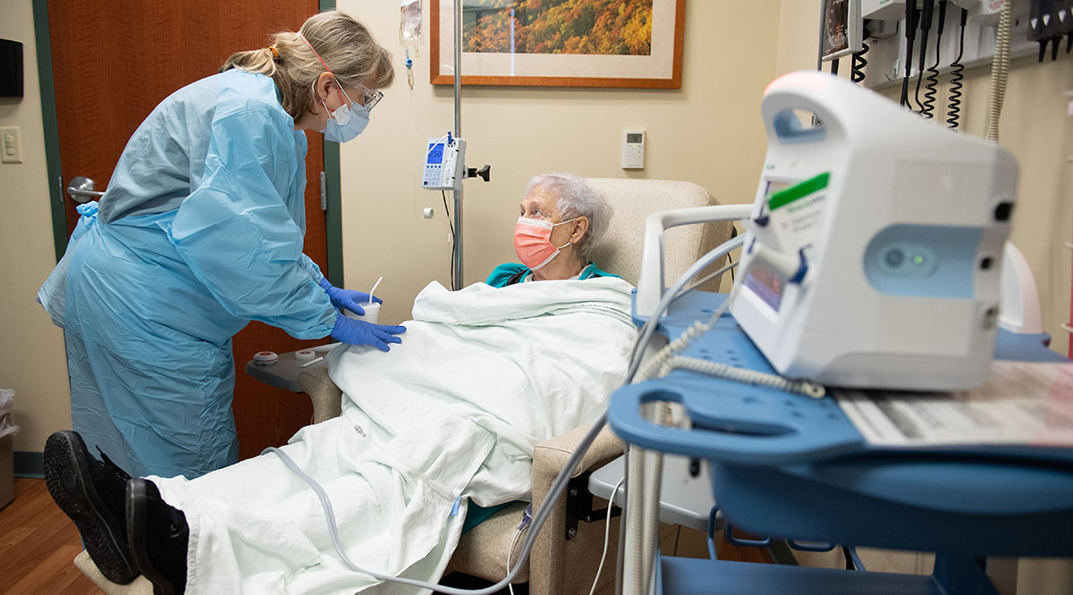 Nurse Pam Burke cares for Sarah Kirby as she receives a monoclonal antibody infusion at Memorial Health System in Illinois.