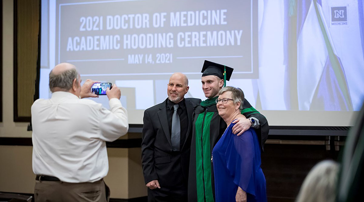 A graduate of the University of Nevada, Reno School of Medicine during the school's hooding ceremony.