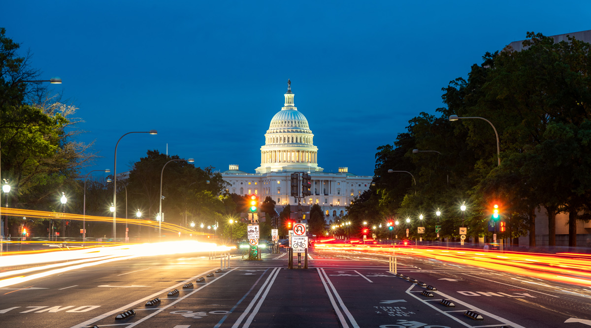 The United States Capitol building at night in Washington DC, USA