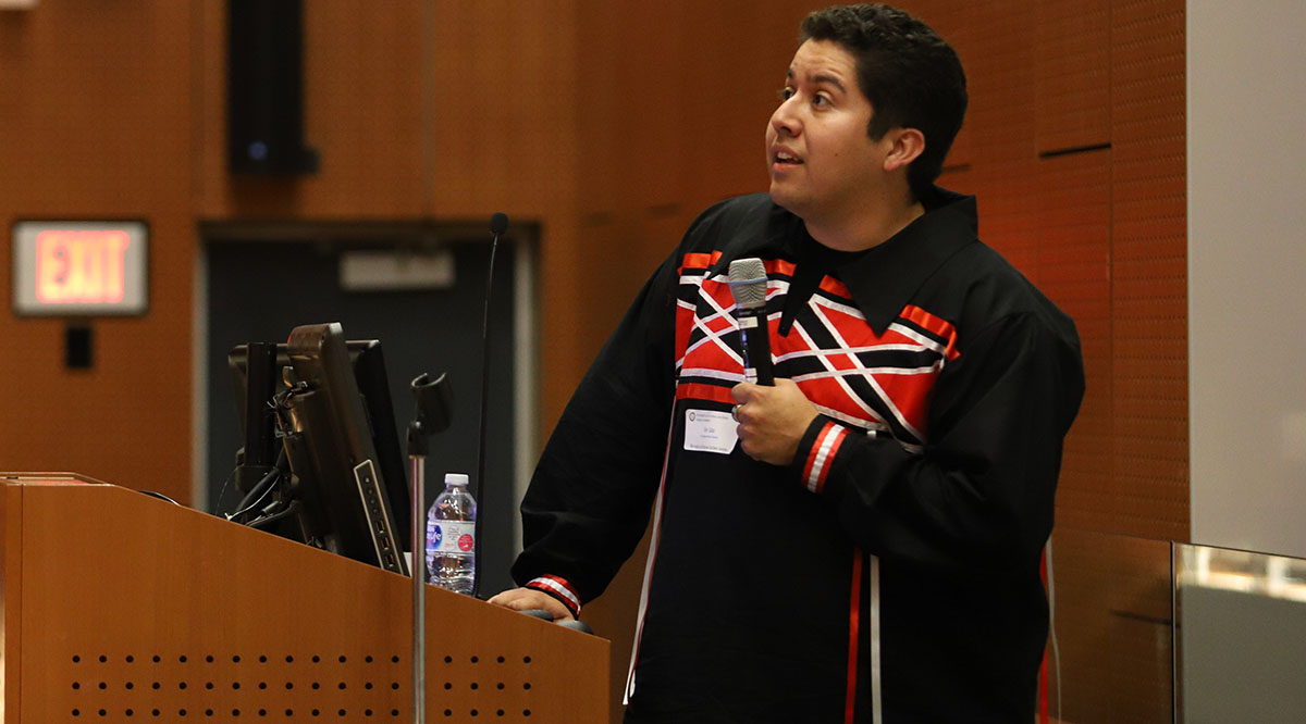 Alec Calac, president of the Association of Native American Medical Students at the University of California (UC), San Diego, School of Medicine, speaks at the medical school in 2019.
