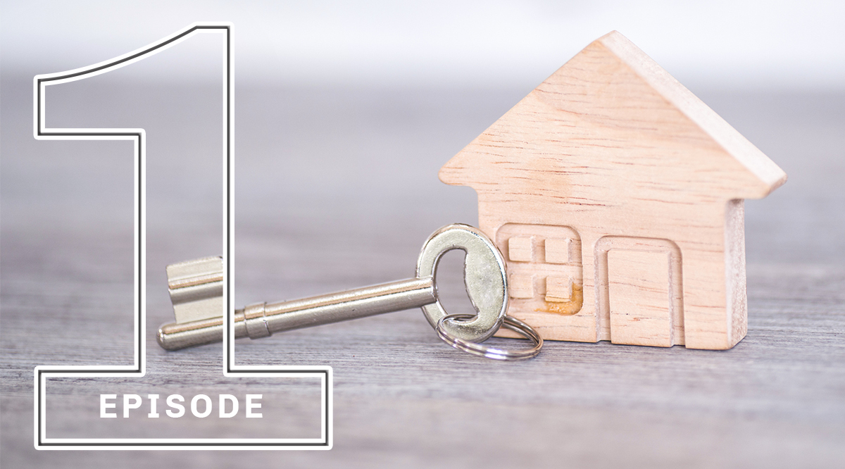 A key with a miniature wooden house
