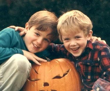 Two children posing with Halloween pumpkin
