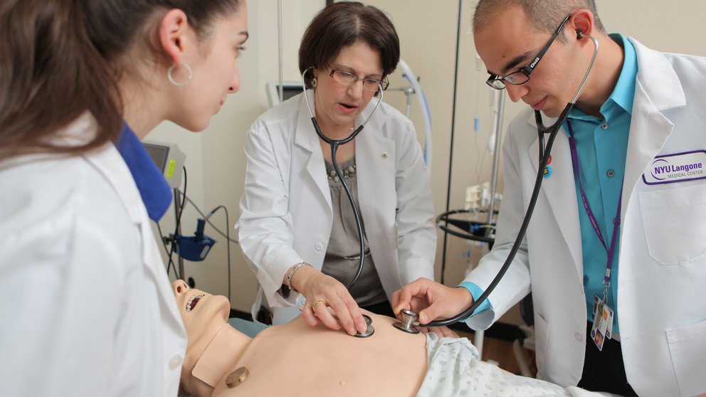 Students practice skills on a mannequin at the New York Simulation Center