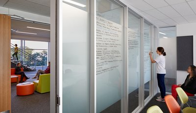 a student at Dell Medical School writing on walls