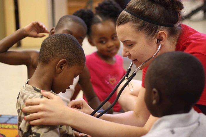 a woman examining a boy
