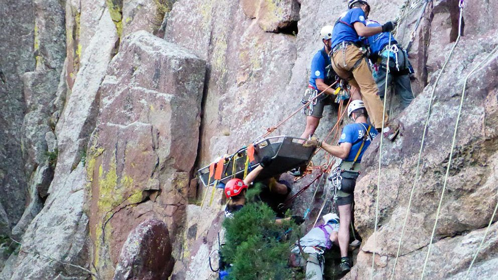 Alison Sheets, MD, medical director of the Rocky Mountain Rescue Group, oversees the rescue of a climber who fell while hiking a sheer rock wall in Eldorado Canyon.