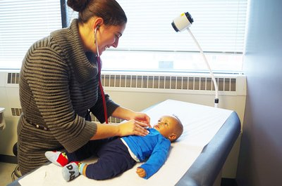 Olga Valdman, MD, treats a child at the refugee health clinic at the Family Health Center of Worcester in Massachusetts.