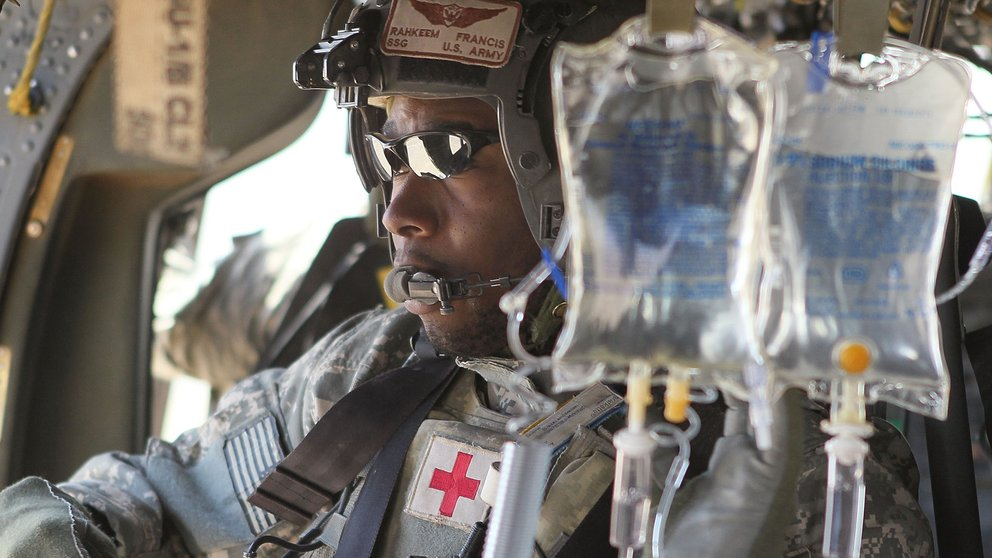 U.S. Army flight medic SSG Rahkeem Francis prepares to receive wounded Marines aboard his MEDEVAC helicopter