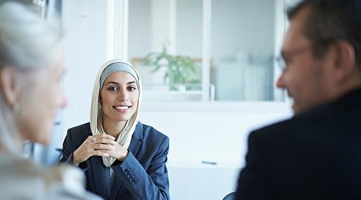 A woman interviews for a job.