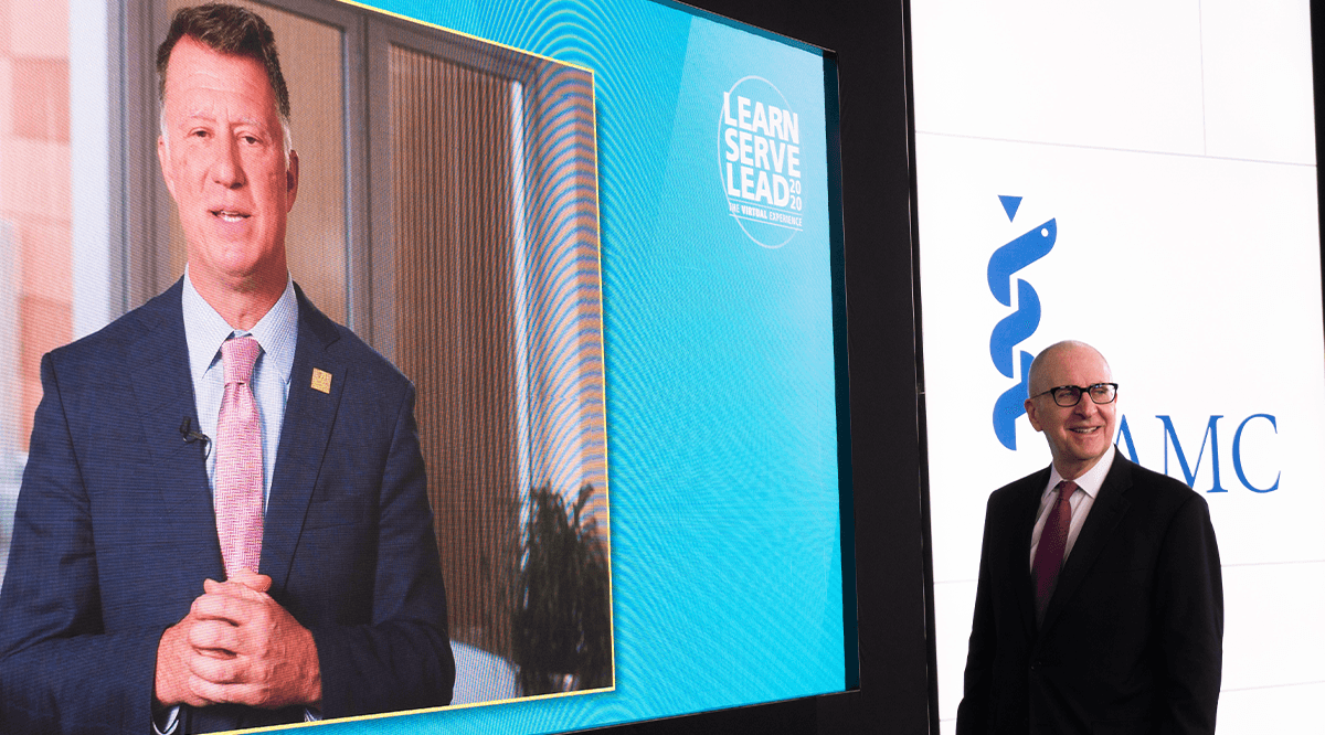 Joseph Kerschner on video screen and David Skorton in studio speaking during Learn Serve Lead 2020