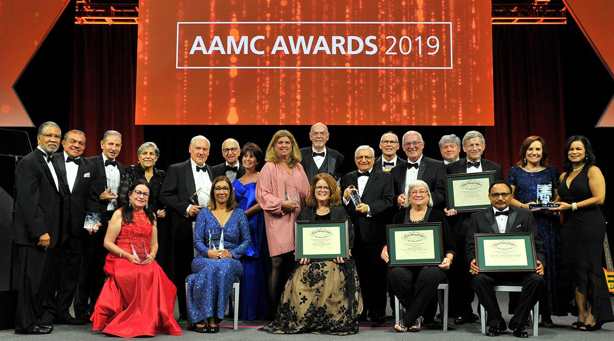 "A large group of people under a sign that says ""AAMC Awards 2019"""