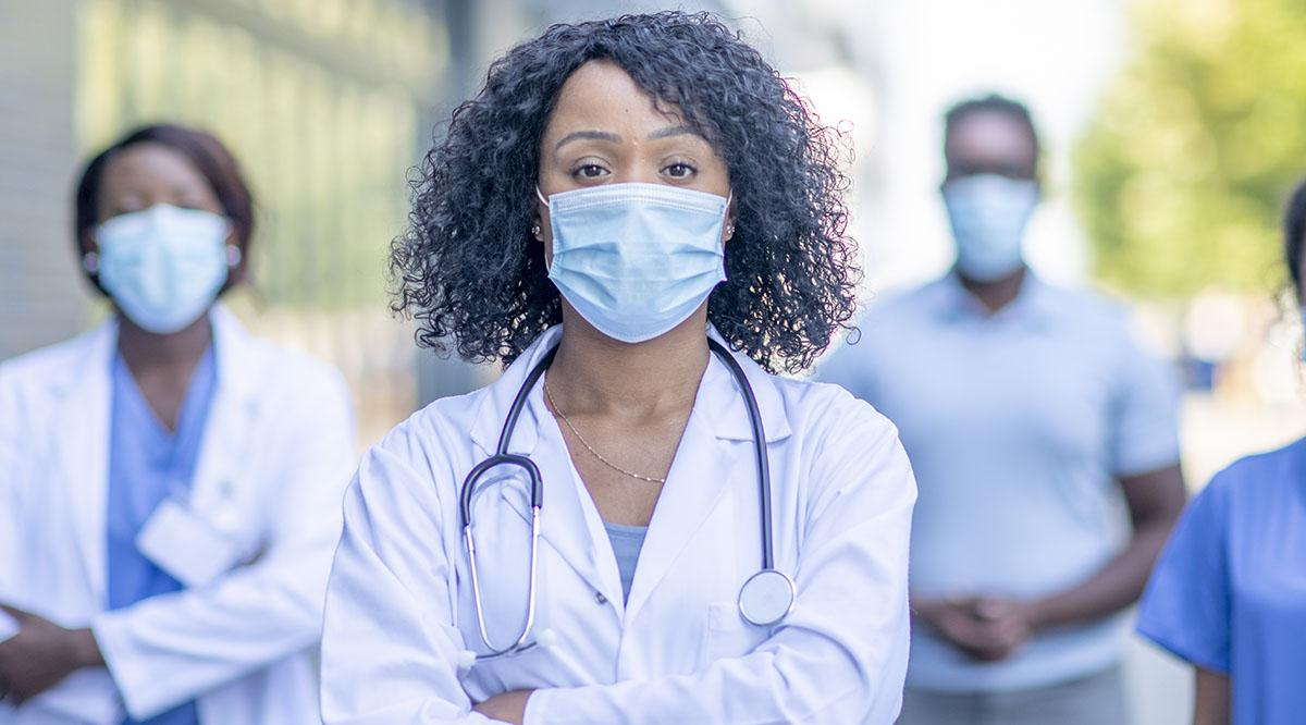 A group of diverse women doctors in masks