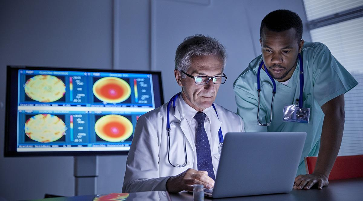 medical doctors viewing scan