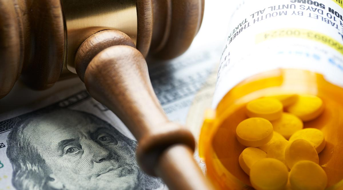 Gavel with pills and money