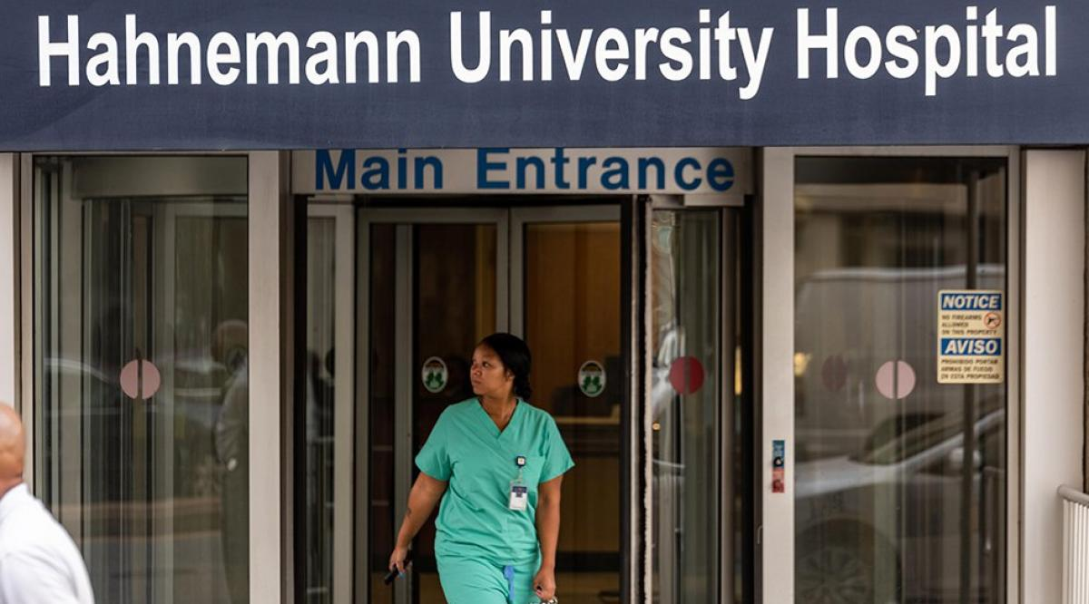 A health care worker exits Hahnemann University Hospital on July 9, 2019. (Christopher Evens/Alamy Stock Photo)
