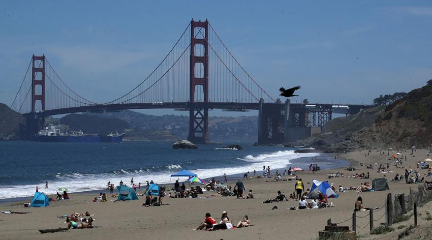People sit on the beach at Baker Beach on May 26, 2020 in San Francisco, California. Beaches across the state have seen large crowds as they have started to slowly reopen.