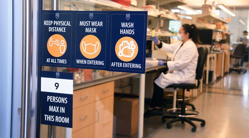 A researcher in a lab at Emory University works under new rules on social distancing and sanitation