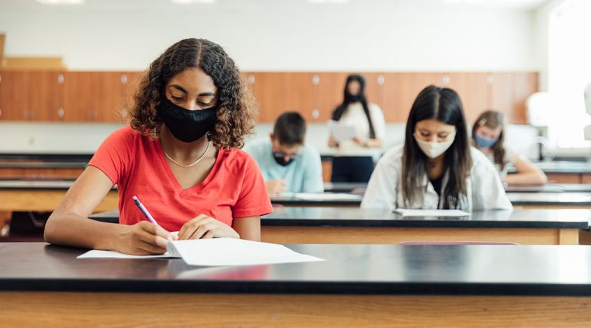 Students study in classroom with masks