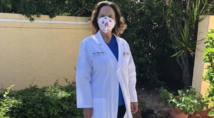 Amy Price, DPhil, a senior research scientist at Stanford Anesthesia Informatics and Media Lab, wears a cloth mask like the ones she and her colleagues tested for efficacy of containing viral particles.