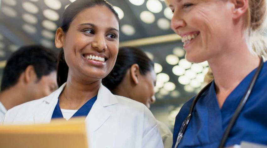 Two female physicians in a conversation