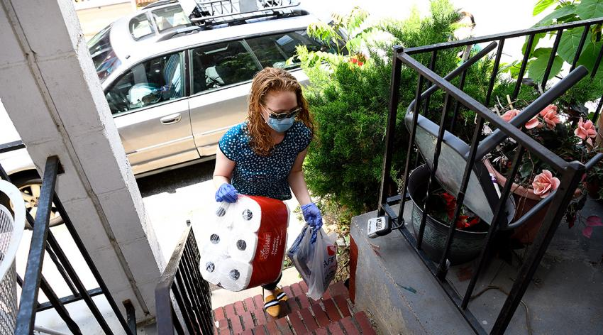 Laura Pugh, a third-year medical student at Johns Hopkins University School of Medicine, delivers groceries to a local senior.