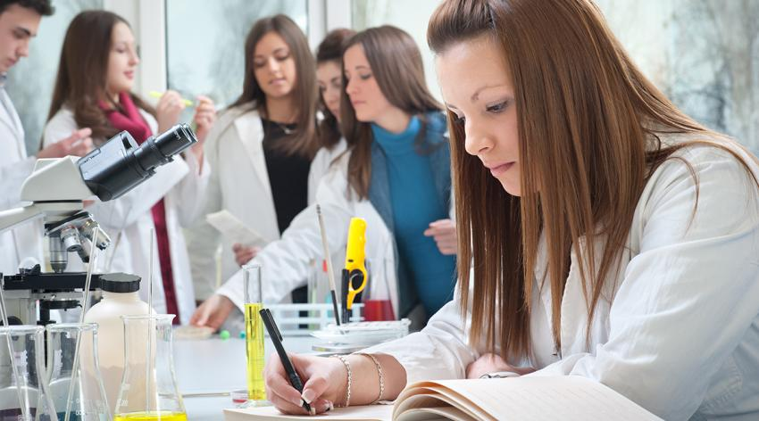 Medical student writing in the laboratory