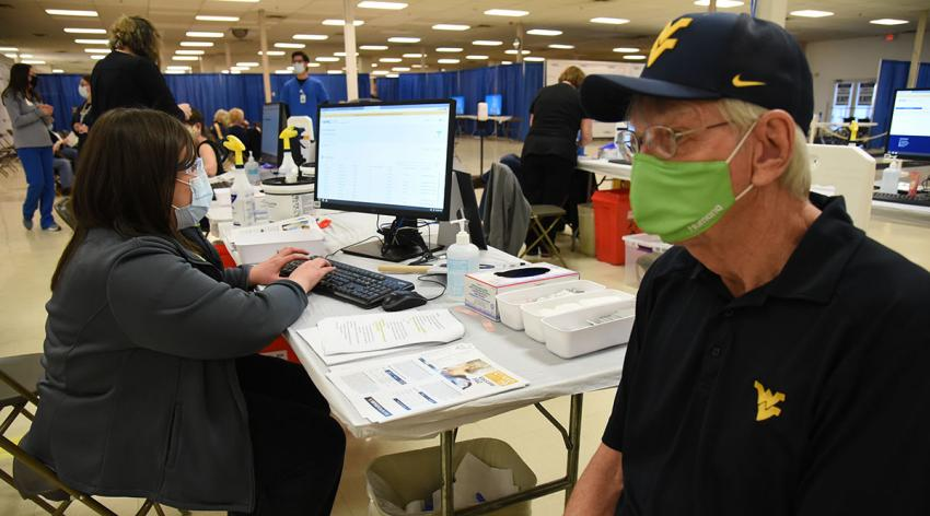 A West Virginia resident is vaccinated on January 25, 2021, at the WVU Medicine and Monongalia County vaccine clinic.